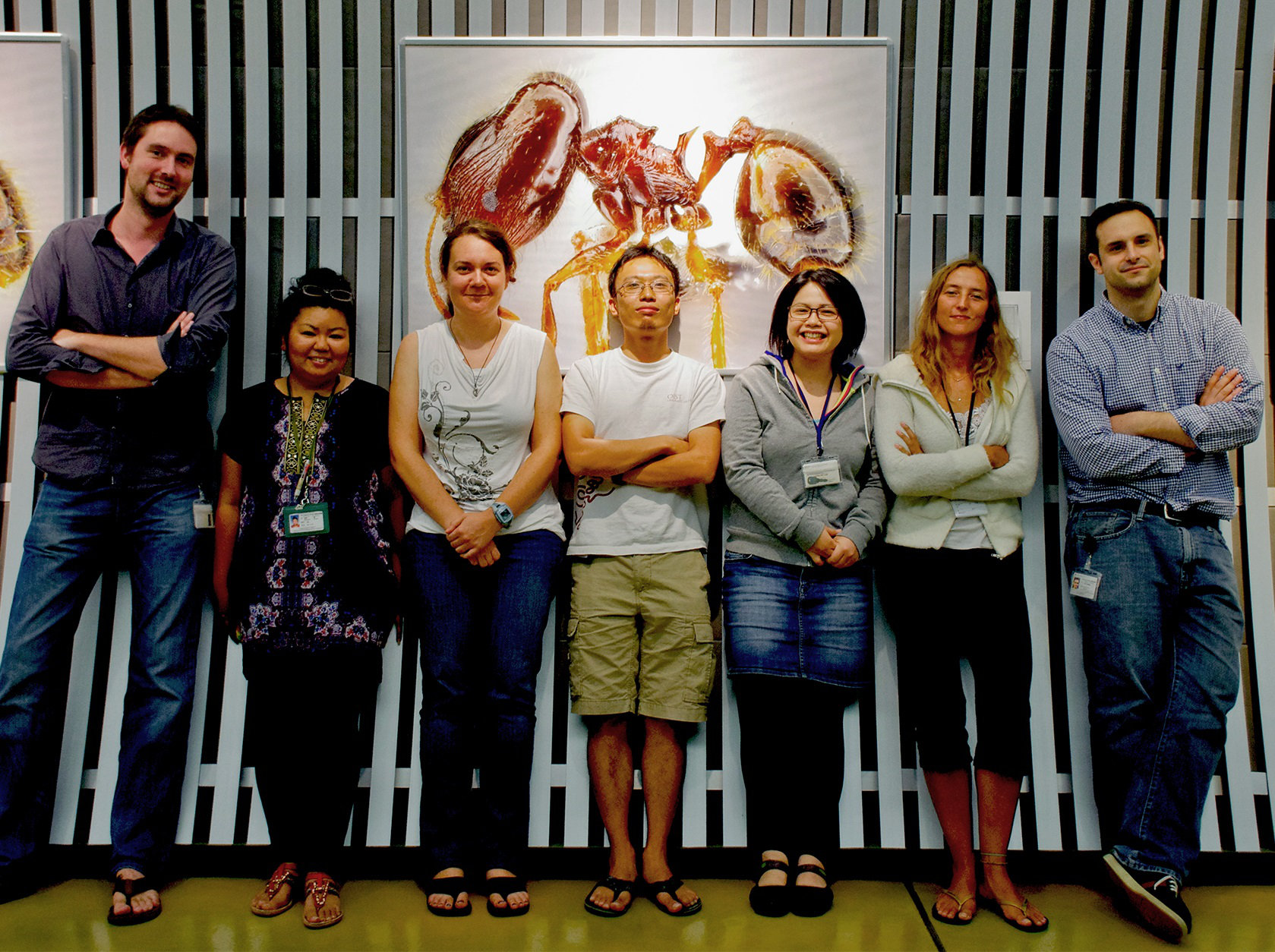 The Arilab team, posing in front of one of the posters.